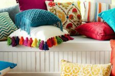 14 some bold pillows and a bright faux fur throw can completely change a neutral space