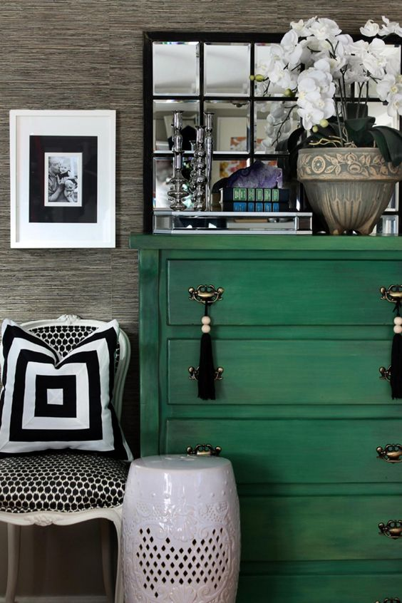 a bold green dresser with metal and tassel handles for a boho feel