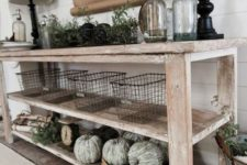 15 a farmhouse whitewashed console with green whitewashed pumpkins, greenery, wire baskets and lamps