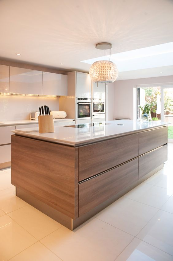 a neutral glam kitchen with a wood clad kitchen island to add texture and interest to the space