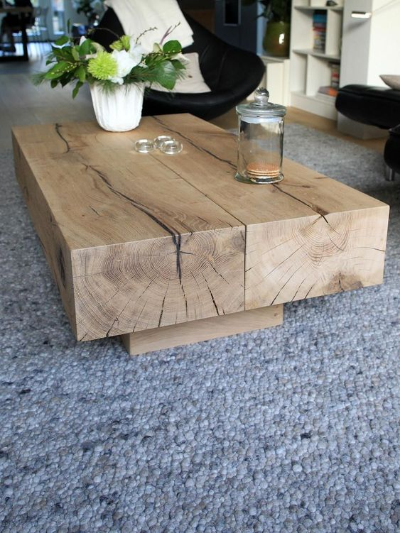 add a touch of nature to your living room with such a low wooden coffee table