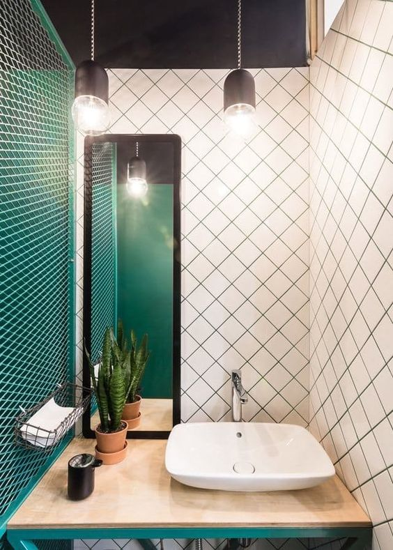an emerald wall, white tiles with emerald grout and emerald framing of the vanity for a wow look
