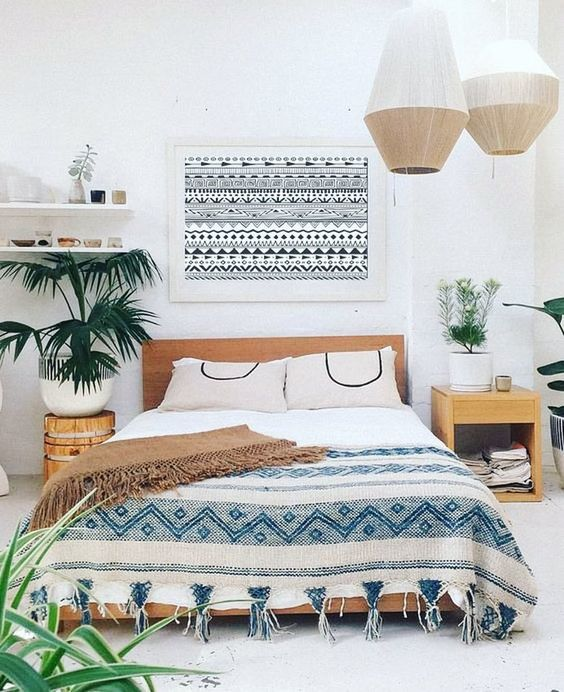 straw pendant lamps, printed textiles, fringe and potted greenery for a slight boho feel
