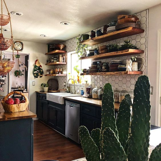 Wooden Shelves And Wicker Baskets Plus Potted Cacti And Greenery For A  Relaxed Look