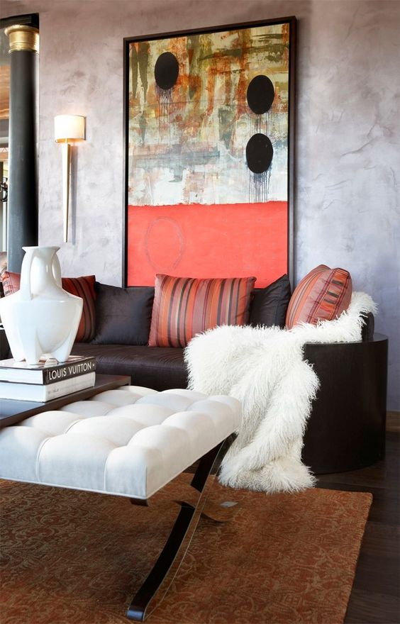 a bold artwork is a must for the plain walls of your living room, it can be oversized