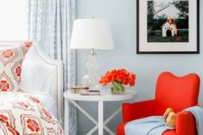 16 a hot red chair on wooden legs adds to the powder blue coastal bedroom