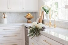 16 add a touch of glam to a usual plain kitchen rocking gold handles and fixtures