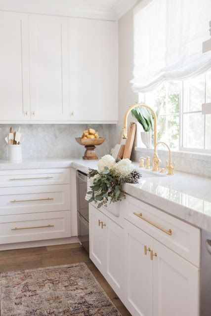 add a touch of glam to a usual plain kitchen rocking gold handles and fixtures