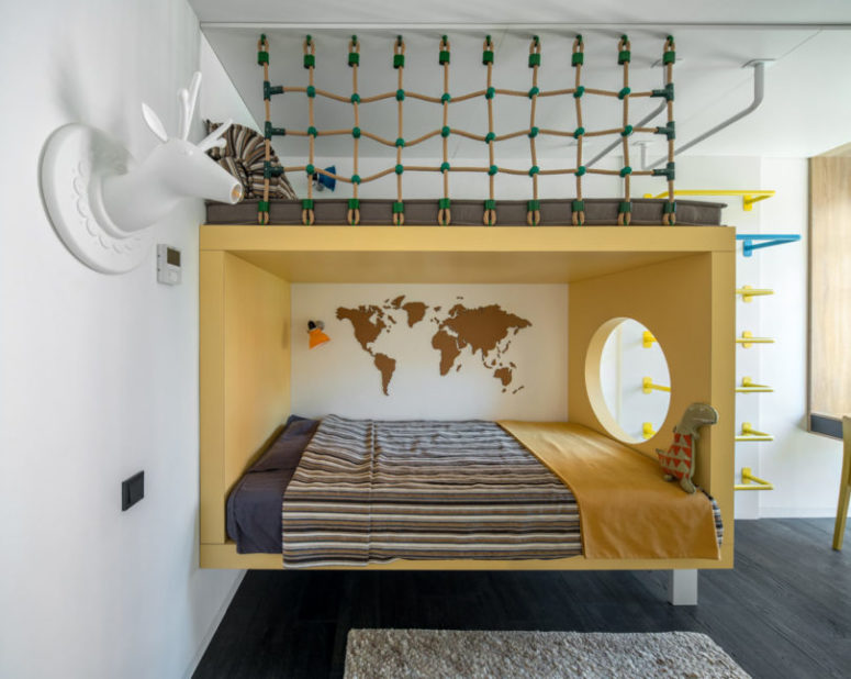 The first kid's room is done with a creative bed with a climbing net on top