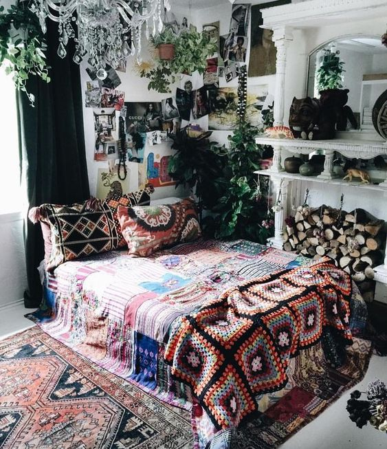 bold boho chic textiles and rugs, some artworks and greenery for a boho yet glam look