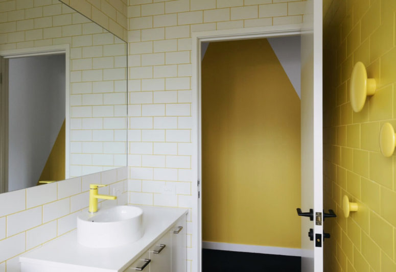 neon yellow grout, fixtures and an accent tile wall with wall hooks, all in yellow