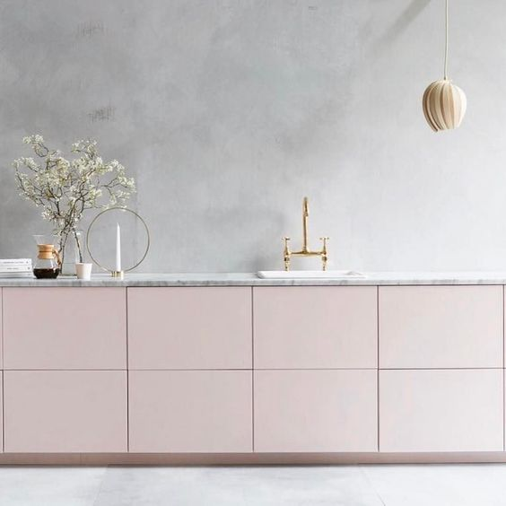 a serene minimalist kitchen with grey plaster walls and blush cabinets is a heavenly beautiful space