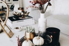 18 a stylish modern fall display with black and white pumpkins with rhinestones, succulents and dried blooms