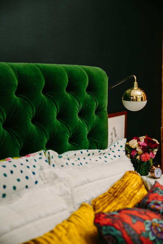 an emerald diamond upholstery headboard is great to add color to a moody space