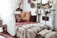 18 boho textiles, fringe, colorful baskets on the wall and alace curtain for an ultimate boho look