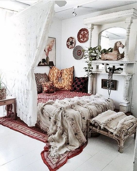 boho textiles, fringe, colorful baskets on the wall and alace curtain for an ultimate boho look