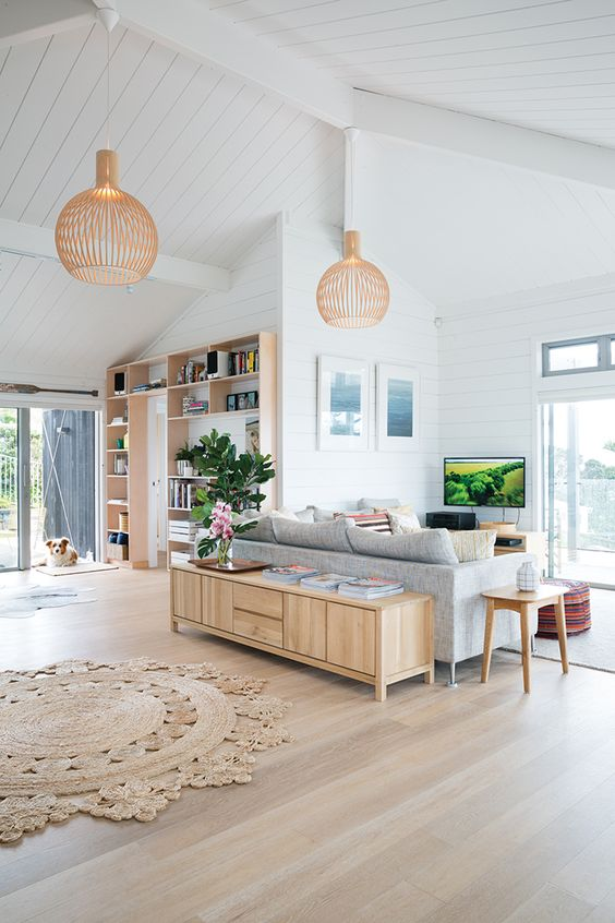 contemporary sleek wooden furniture in each part of the open layout ties them up for a unified look