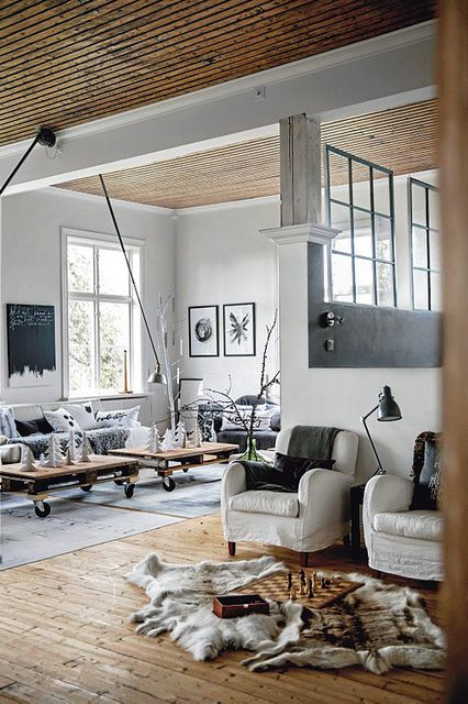white furniture in different parts of the open layout is the easiest way to tie up the spaces