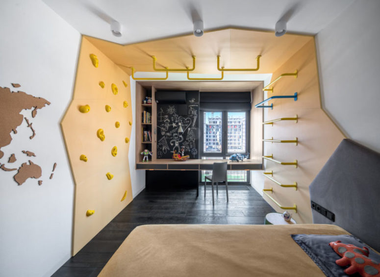 The second kid's room is similar, also done in grey and bright yellow, with a chalkboard wall and a study space