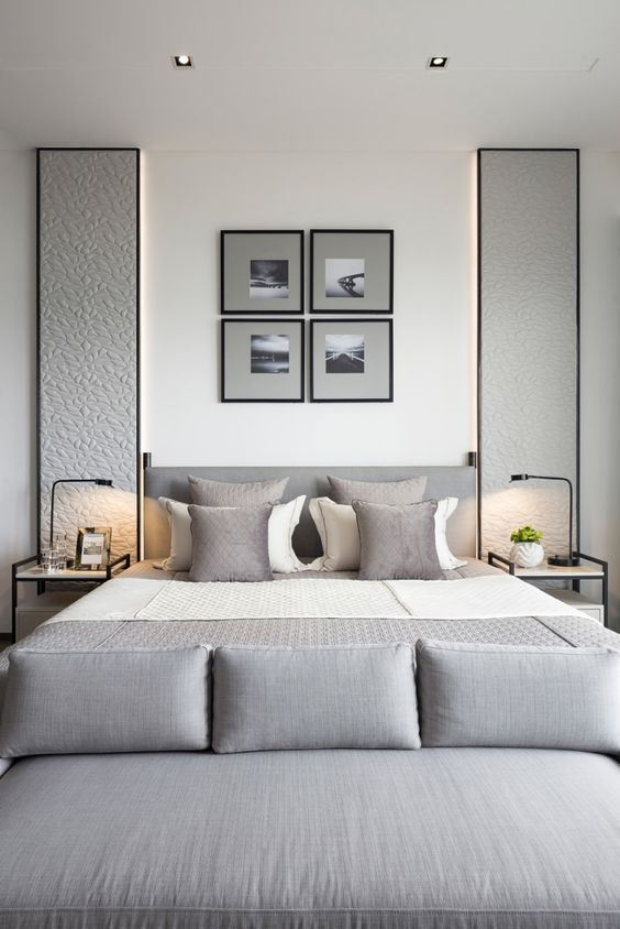 a gallery wall over the bed and cool upholstered panels on each side of the bed