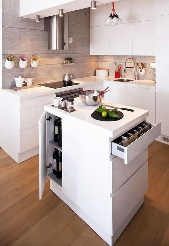 a small minimalist kitchen island with much storage space inside and a cooktop