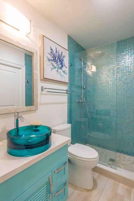 a turquoise glass sink and a matching vanity plus a tile shower wall is a great color statement