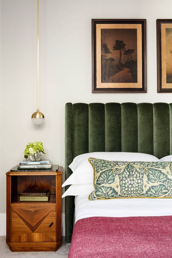 an earthy green upholstered bed is a color statement and a cozy piece for sleeping