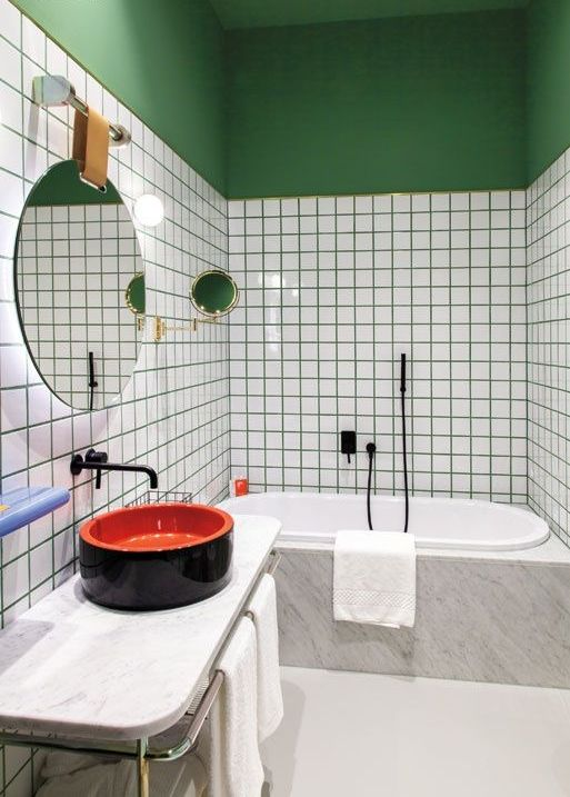 emerald grout and a painted half wall and a ceiling for a trendy and colorful bathroom