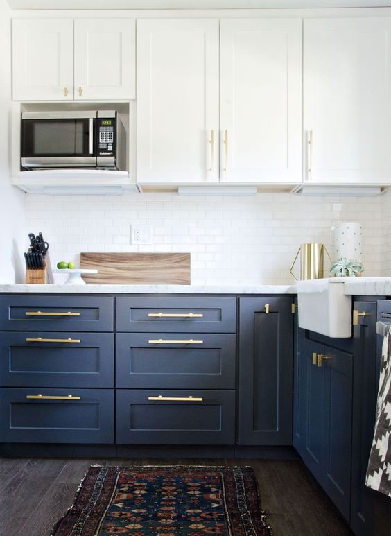 unify the cabinet look using the same brass handles and make a cool glam accent with them