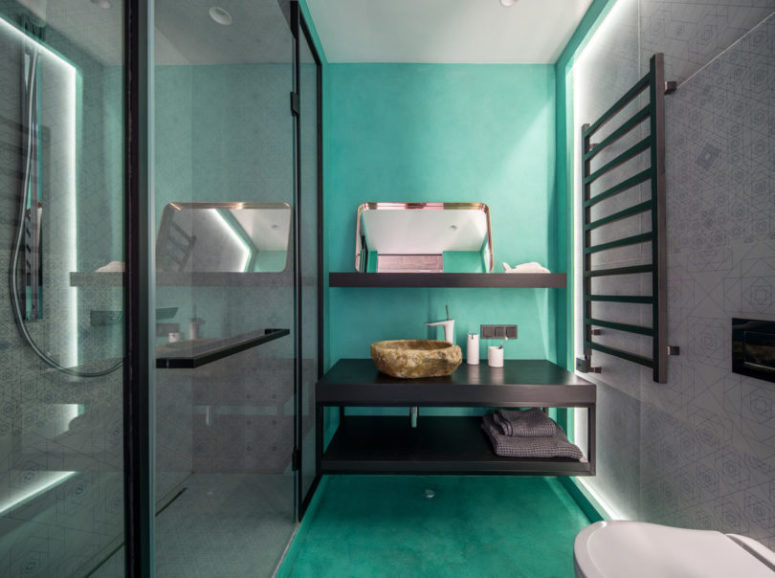 The kids' bathroom is done in black, white and bright turquoise to make it more welcomign for kids yet cheerful