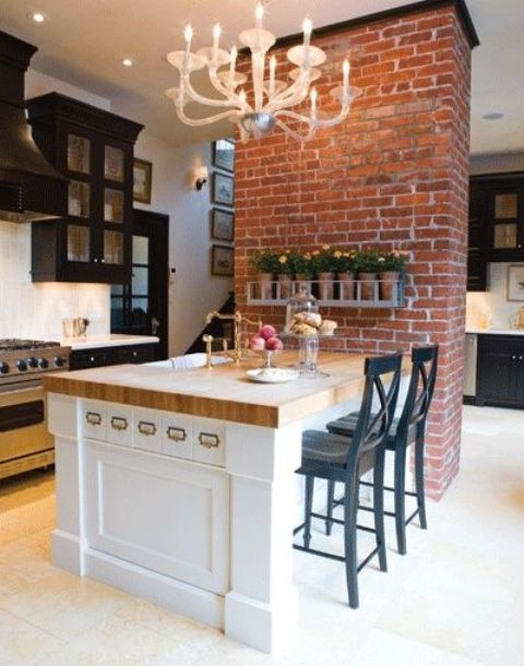 a large kitchen island that doubles as a dining space and save a lot of space in the kitchen