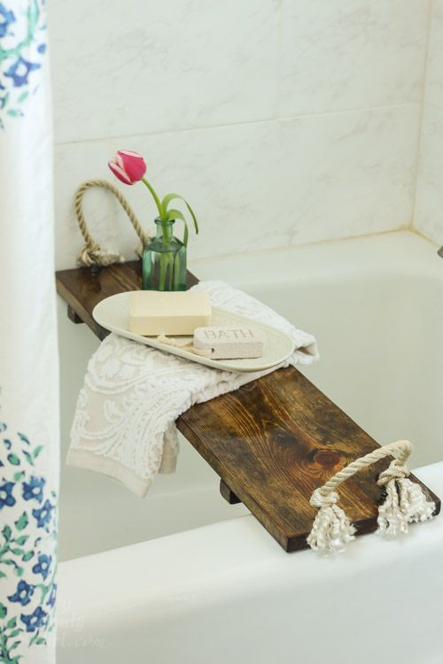 a rustic bathroom caddy of a stained wood piece and thick rope - such an item can be easily DIYed