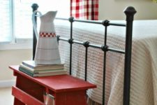 20 a simple red bench at the footrest is a creative idea for storage and adding a farmhouse feel