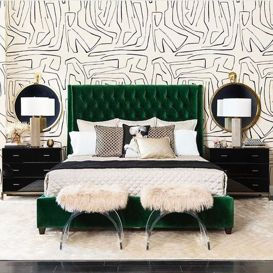 an emerald upholstered bed adds color to this monochromatic space