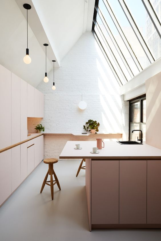 blush cabinets in a white attic kitchen create a subtle and tender look