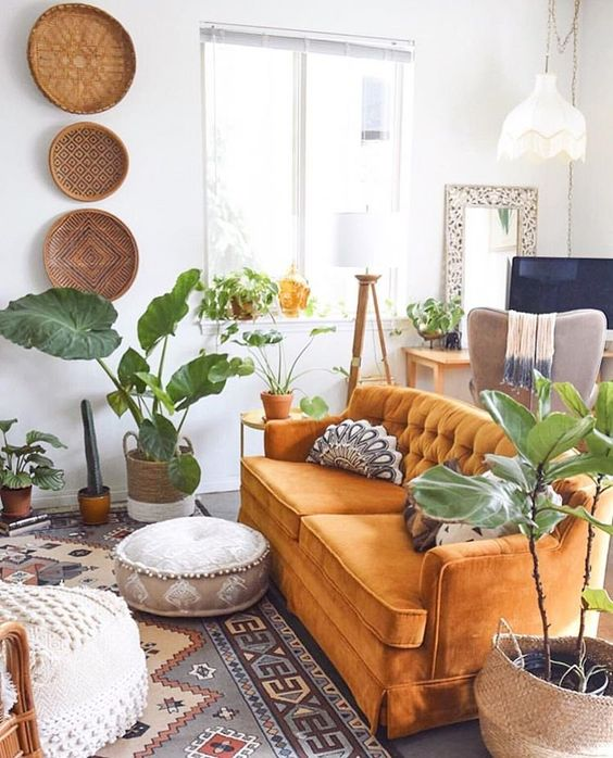 lots of potted greenery and boho baskets on the wall plus boho textiles for a free spirited space