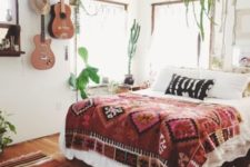 20 potted greenery, boho textiles and real guitars hanging on the wall for a free-spirited touch