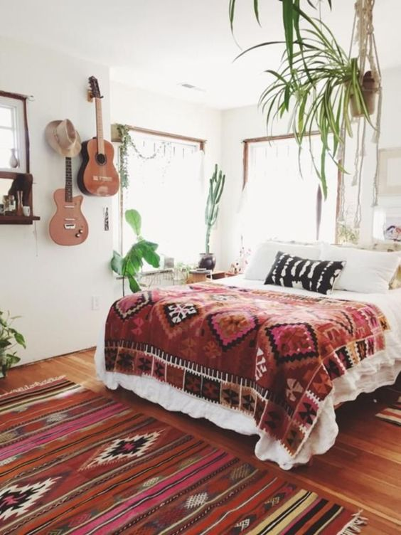 potted greenery, boho textiles and real guitars hanging on the wall for a free-spirited touch