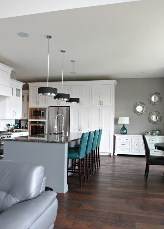 touches of teal is a chic idea for a grey and white space and a bold color splash