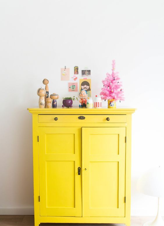 a bright yellow cabinet is a nice idea to add color and make an accent
