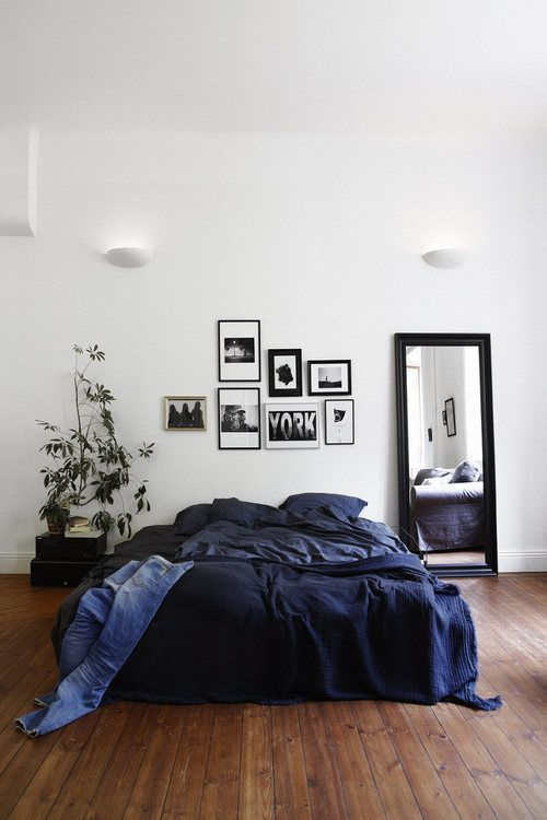a gorgeous navy bedding set is a great and easy idea to add a masculine feel to the space