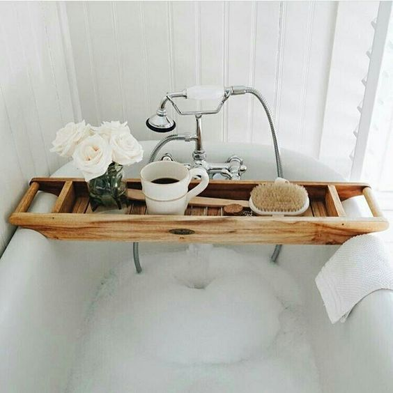 a modern wooden caddy with handles and a deep tray adds a spa feel to the bathroom