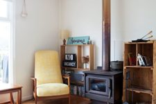 21 a simple hearth nook with a colorful rug, pillow and a bright chair for spending time here