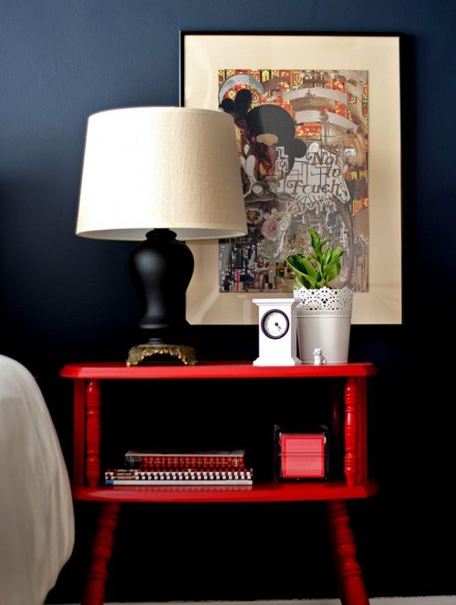 a vintage farmhouse nightstand painted red is a simple idea to add color to your space