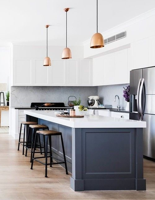 an elegant modern white kitchen with a grey kitchen island with a thick white countertop