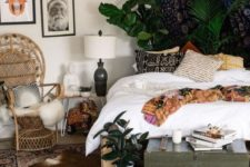 21 lots of boho rugs, boho pillows, a wicker chair and a green chest for storage
