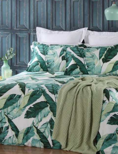 a bedding set in the shades of green and with a palm leaf print for a bright touch