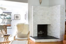 23 a cozy fireplace nook with a leather chair and a footrest plus a cowhide rug for reading