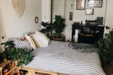 23 a macrame wall hanging, potted greenery and a boho rug are all you need for a boho chic feel