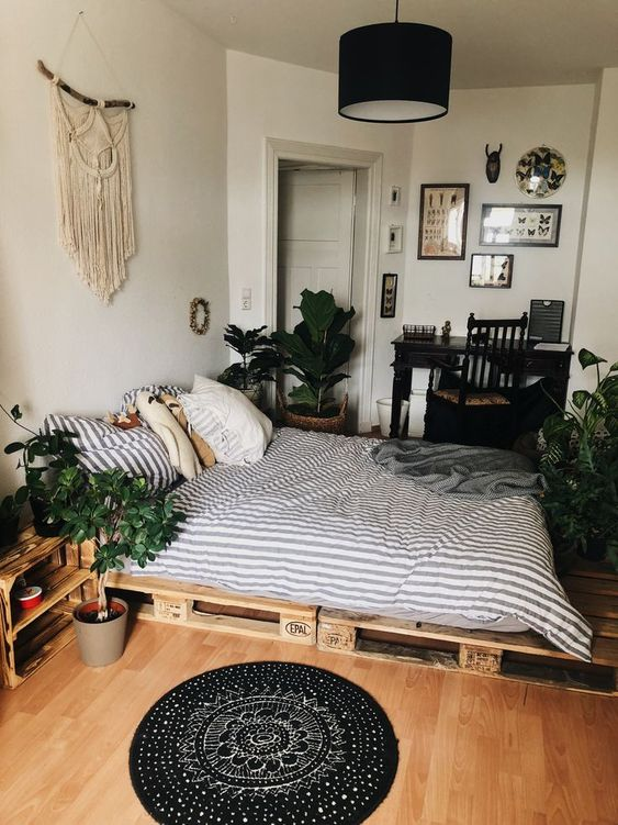 a macrame wall hanging, potted greenery and a boho rug are all you need for a boho chic feel